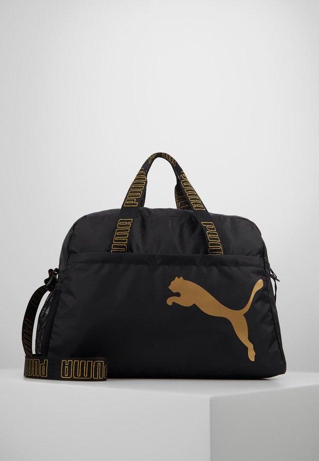 GRIP BAG - Sports bag - black/metallic gold