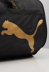 Puma - BARREL BAG - Sportovní taška - black/metallic gold - 2
