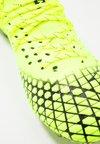 Puma - FUTURE 4.1 NETFIT FG/AG - Voetbalschoenen met kunststof noppen - yellow alert/black