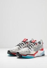 Puma - LQDCELL OPTIC - Chaussures de running neutres - high rise/high risk red - 2