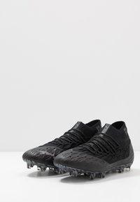 Puma - FUTURE 5.1 NETFIT FG/AG - Voetbalschoenen met kunststof noppen - black/asphalt - 2