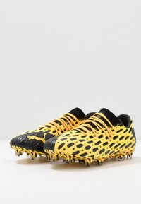 Puma - FUTURE 5.1 NETFIT LOW FG/AG - Chaussures de foot à crampons - ultra yellow/black - 2