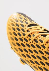 Puma - FUTURE 5.4 FG/AG - Korki Lanki - ultra yellow/black - 5