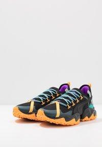 Puma - ERUPT TRL - Zapatillas de trail running - black/blue turquoise - 2