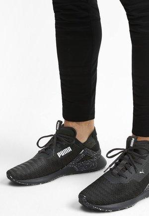 ROGUE - Chaussures de running stables - black