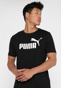 Puma - LOGO TEE - Camiseta estampada - cotton black - 0