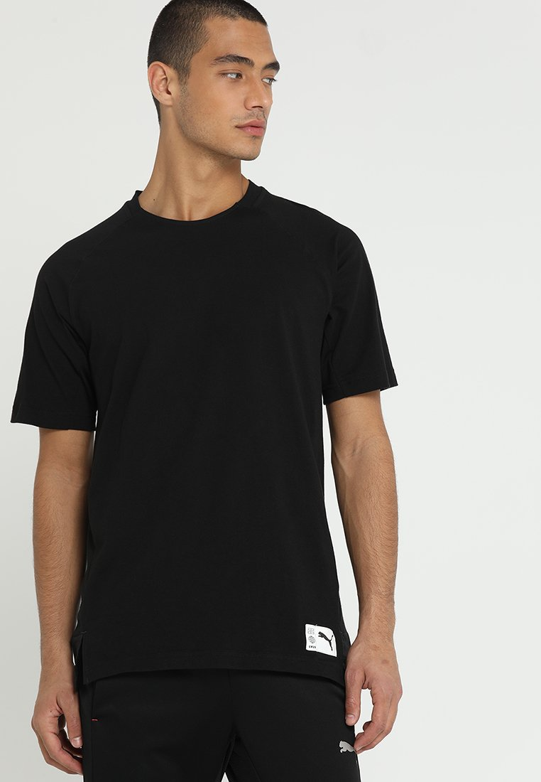 Puma - CASUALS GRAPHIC TEE - T-shirts print - black/charcoal gray