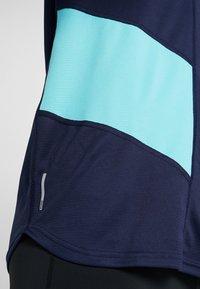 Puma - IGNITE TEE - Print T-shirt - peacoat blue/turquoise - 6