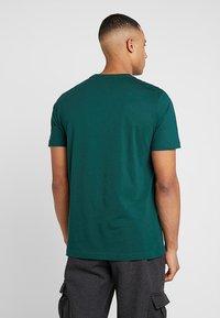 Puma - SMALL LOGO TEE - T-shirt basic - green - 2