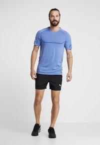 Puma - ENERGY SEAMLESS TEE - T-shirt imprimé - galaxy blue heather - 1