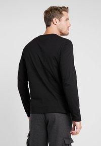Puma - LOGO TEE - T-shirt à manches longues - black - 2
