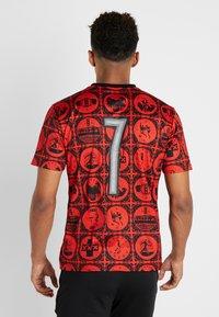Puma - AMSTERDAM - T-shirt con stampa - red/black - 2