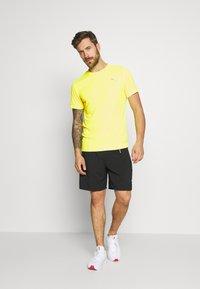 Puma - LAST LAP TEE - Camiseta básica - yellow alert - 1
