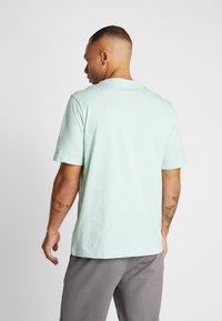 Puma - TEE - T-shirt imprimé - mist green - 2
