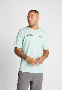 Puma - TEE - T-shirt imprimé - mist green - 0