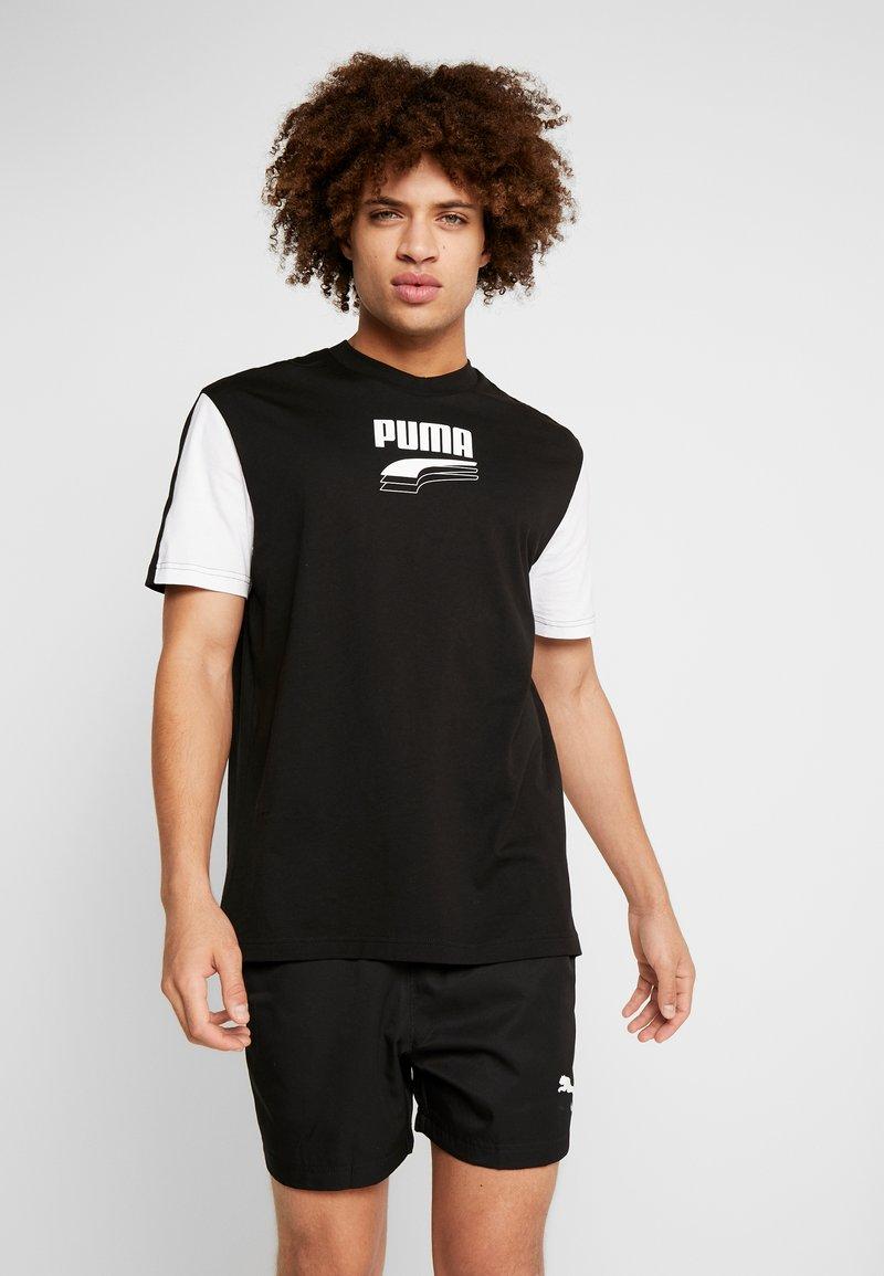 Puma - REBEL BLOCK TEE - Camiseta estampada - black