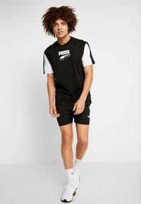 Puma - REBEL BLOCK TEE - Camiseta estampada - black - 1