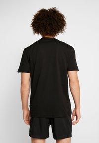 Puma - REBEL BLOCK TEE - Camiseta estampada - black - 2