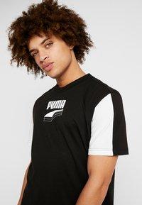 Puma - REBEL BLOCK TEE - Camiseta estampada - black - 3