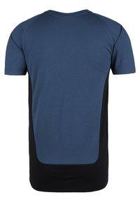 Puma - EVOSTRIPE - Basic T-shirt - dark blue - 1