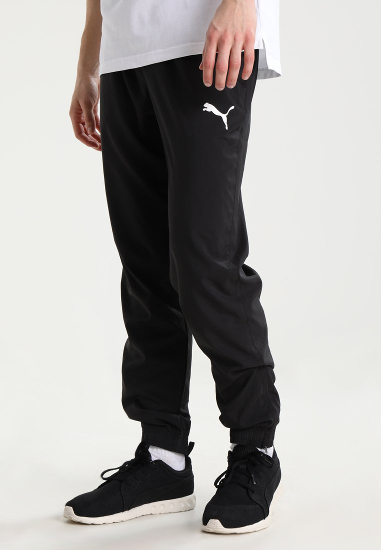 Puma - Jogginghose - black