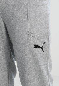 Puma - LIGA CASUALS PANTS - Trainingsbroek - medium gray heather/black - 3