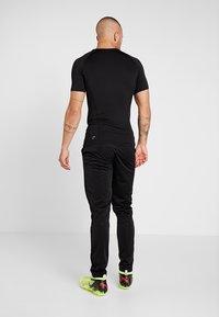 Puma - LIGA TRAINING PANT CORE - Pantalones deportivos - puma/white - 2