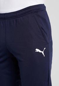 Puma - LIGA TRAINING PANTS - Spodnie treningowe - peacoat/white - 5