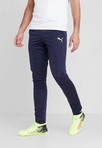 Puma - LIGA TRAINING PANTS - Spodnie treningowe - peacoat/white - 0