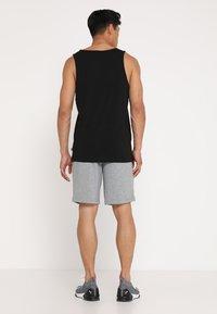 Puma - BERMUDAS - Sports shorts - medium gray heather - 2