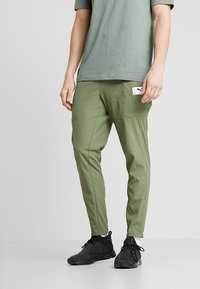 Puma - CASUAL PANTS - Träningsbyxor - olivine/charcoal gray - 0