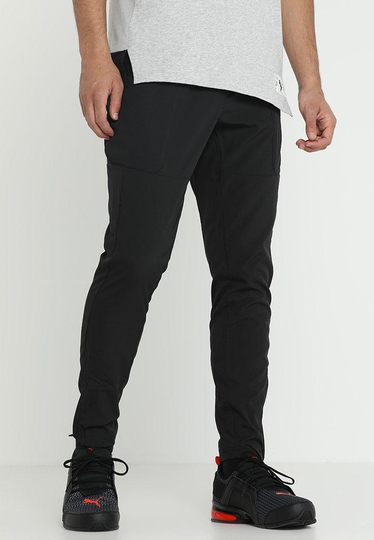 Puma - CASUAL PANTS - Tracksuit bottoms - black/charcoal grey