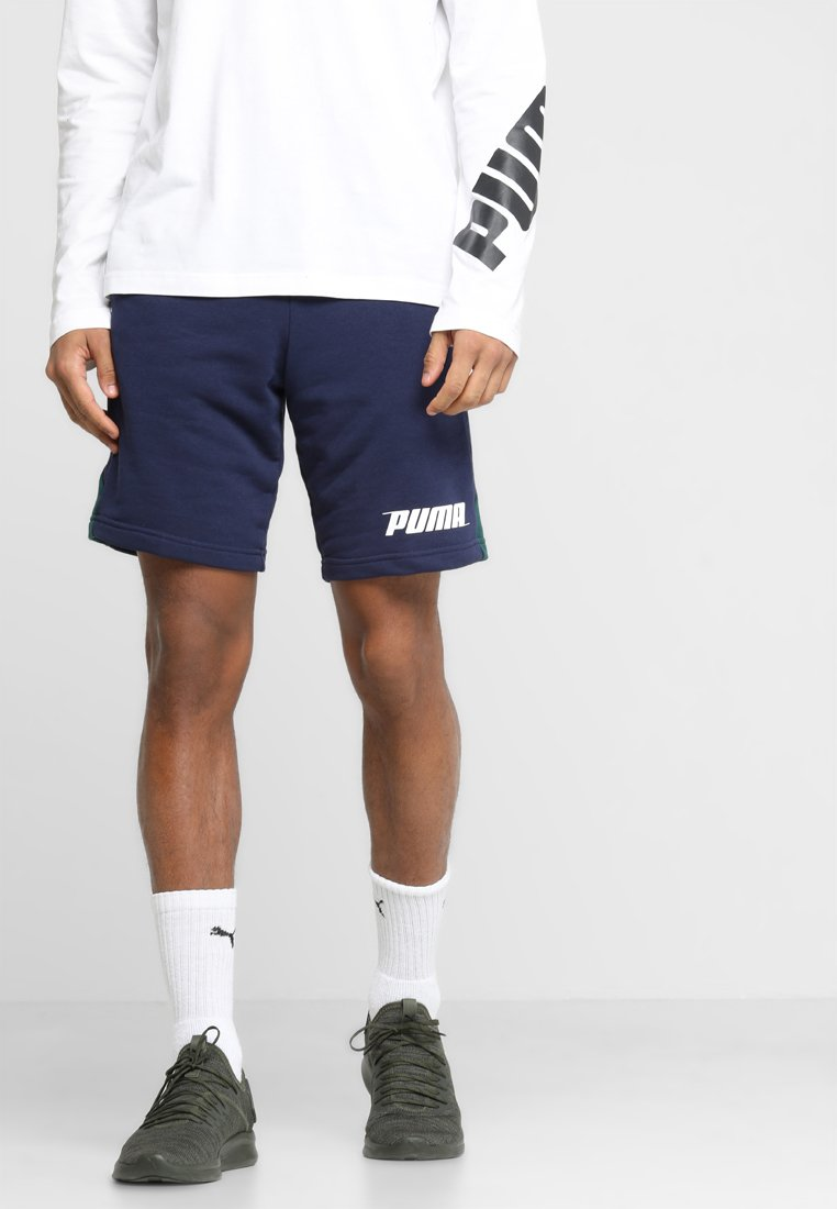 Puma - REBEL SHORTS - kurze Sporthose - peacoat