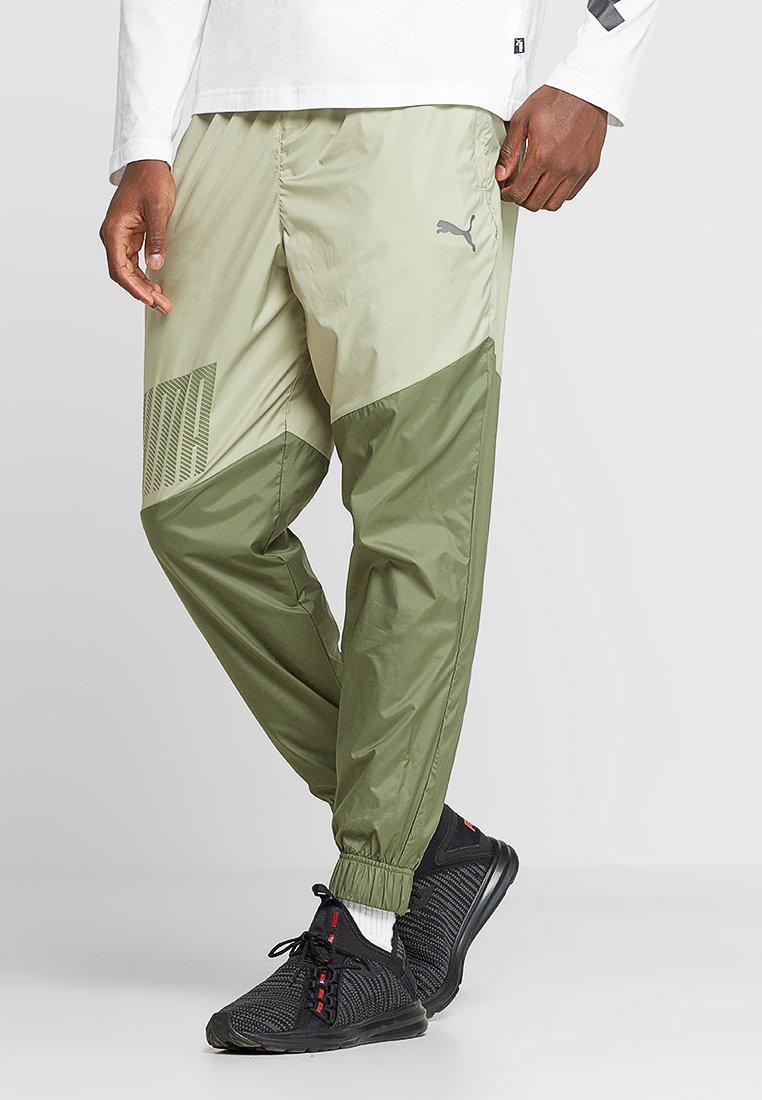 Puma - A.C.E. TRACKSTER - Pantaloni sportivi - elm/olivine
