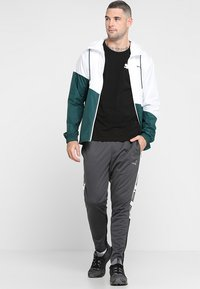 Puma - TRACK PANT  - Teplákové kalhoty - asphalt/puma black/puma white - 1