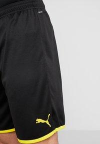 Puma - BVB BORUSSIA DORTMUND SHORTS REPLICA - Krótkie spodenki sportowe - black/cyber yellow - 3