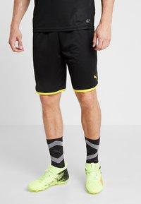 Puma - BVB BORUSSIA DORTMUND SHORTS REPLICA - Krótkie spodenki sportowe - black/cyber yellow - 0