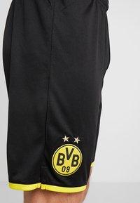 Puma - BVB BORUSSIA DORTMUND SHORTS REPLICA - Krótkie spodenki sportowe - black/cyber yellow - 4