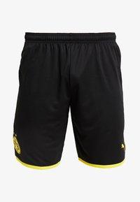 Puma - BVB BORUSSIA DORTMUND SHORTS REPLICA - Krótkie spodenki sportowe - black/cyber yellow - 5