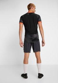 Puma - SHORTS - Sports shorts - ebony - 2