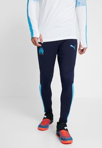 Puma - OLYMPIQUE MARSAILLE TRAINING PANTS PRO WITH ZIPPED POCKETS - Equipación de clubes - peacoat - 0