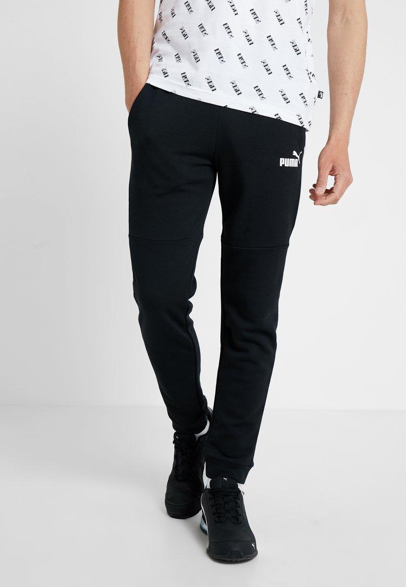 Puma - AMPLIFIED PANTS - Träningsbyxor - black