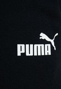 Puma - AMPLIFIED PANTS - Träningsbyxor - black - 6
