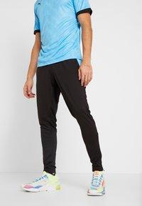 Puma - PANT - Pantalon de survêtement - puma black/luminous blue - 0