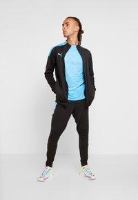 Puma - PANT - Pantalon de survêtement - puma black/luminous blue - 1