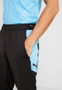 Puma - PANT - Pantalon de survêtement - puma black/luminous blue - 4