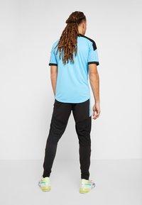 Puma - PANT - Pantalon de survêtement - puma black/luminous blue - 2