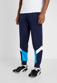 Puma - OLYMPIQUE MARSEILLE ICONIC TRACK PANTS - Pantalon de survêtement - peacoat - 0