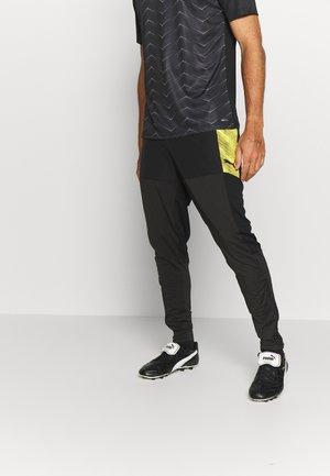 FTBLNXT PRO PANT - Pantalon de survêtement - black/ultra yellow