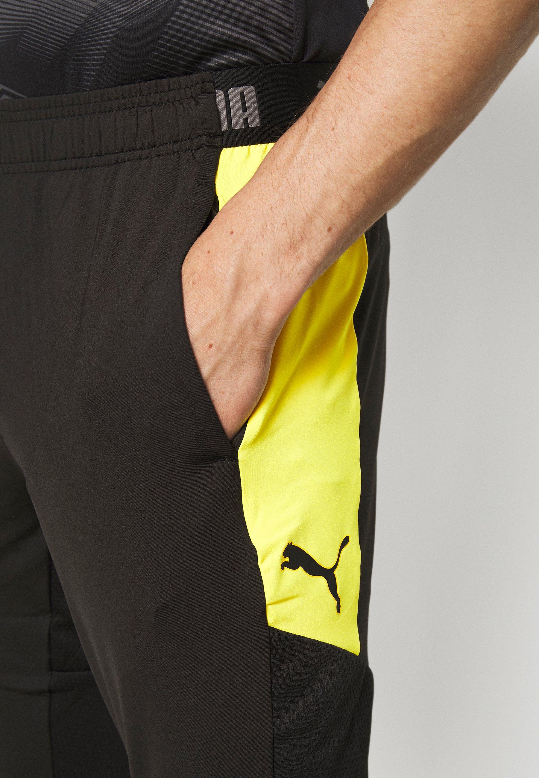 Puma 34 PANTS 34 sportbroek blackultra yellow